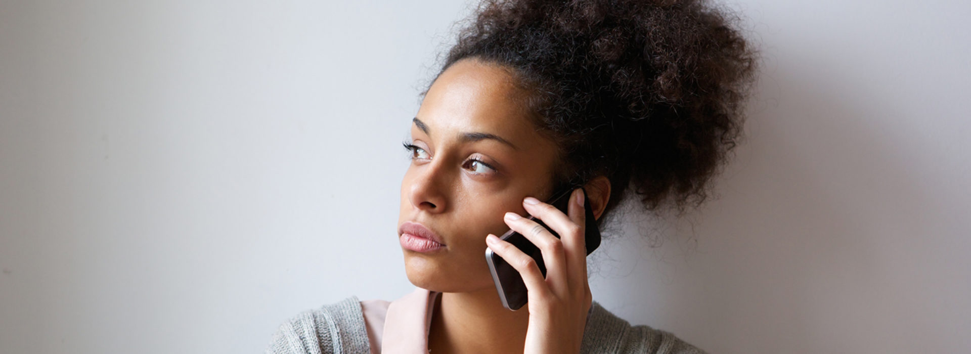 Concerned black woman on phone