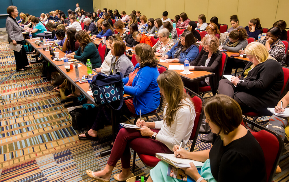 2017 Prevention Conference attendees take notes during a session.