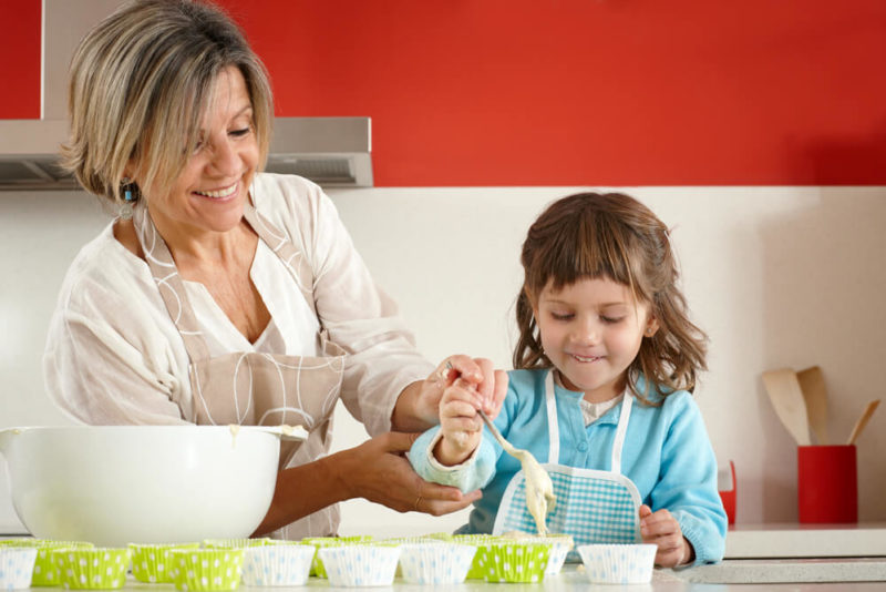 Grandmother-making-cupckaes-with-grandaughter