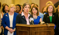 Sue Williams speaks at Children's Advocacy Day at the State House