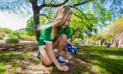 USC Kappa Delta plants a pinwheel at Davis Field as part of Kappa Delta's efforts to put a spotlight on Child Abuse Prevention Month.