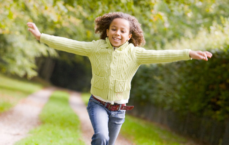 Young-teenage-girl-running-outside