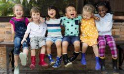 Happy children sitting together