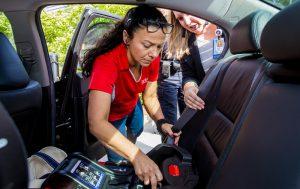 Child-Car-Seat-Technician-installs-car-seat