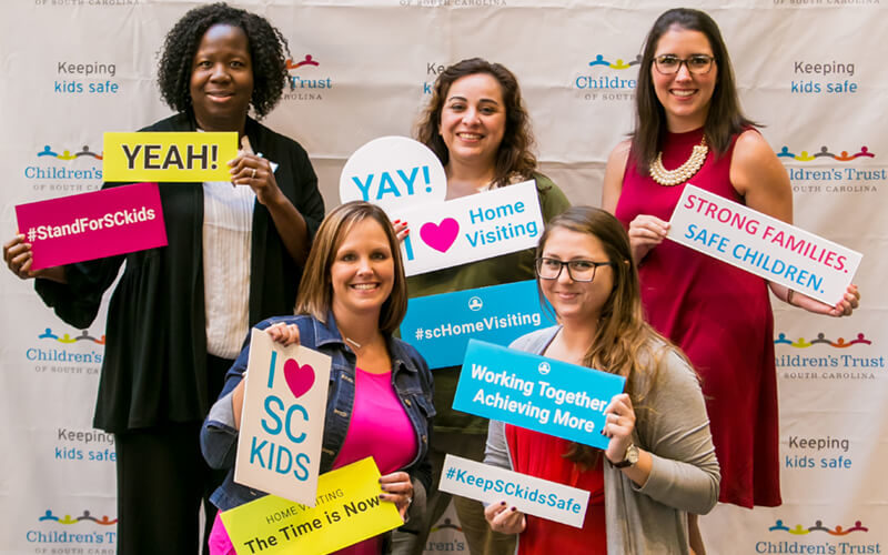 Home-Visiting-Summit-2016-attendees-at-photo-booth