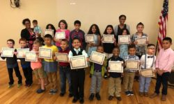 Children holding graduation certificates at SFP ceremony