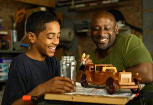 Son painting model truck with father