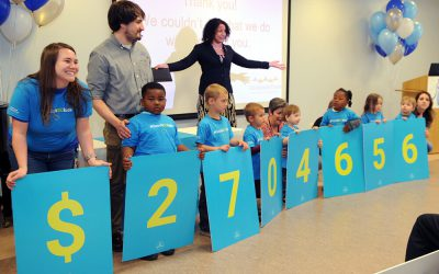 Upstate-Investment-Announcement-Kids-holding-dollar-amount-signs