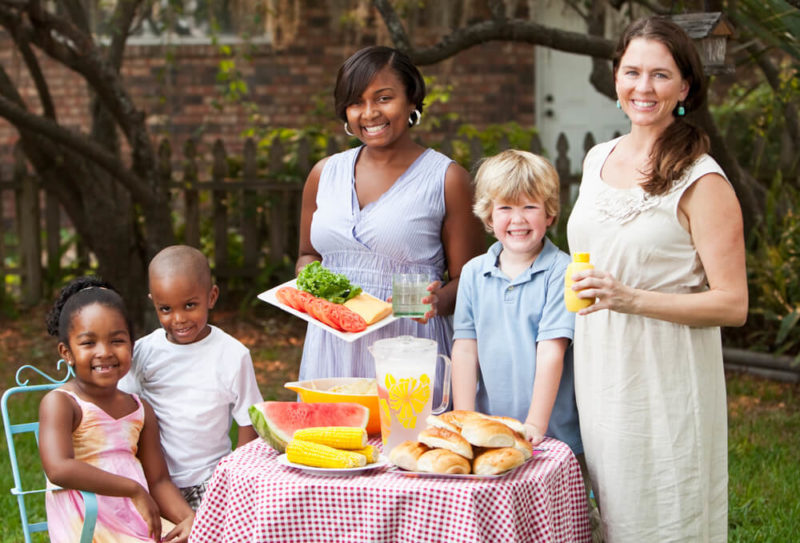 Two-mothers-and-children-backyard-cookout