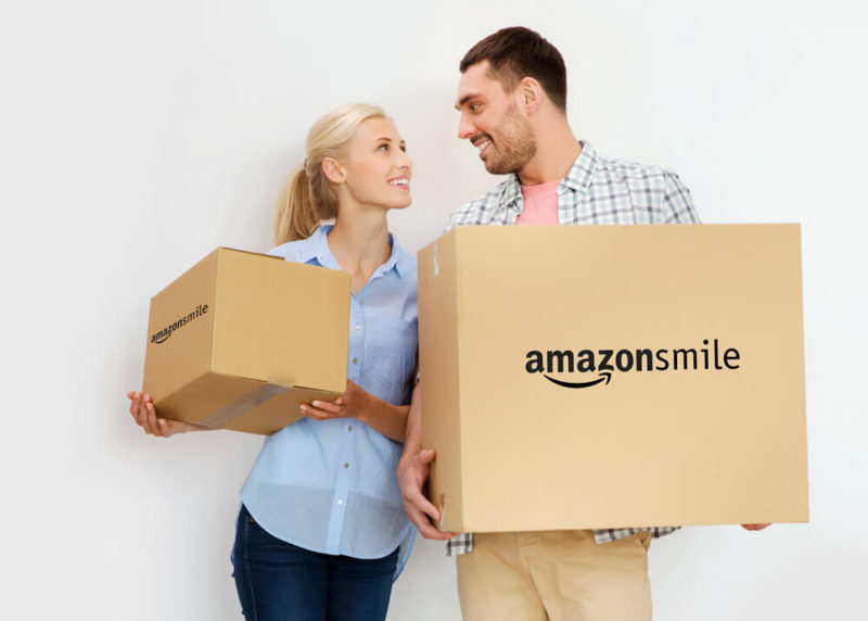 Couple holding boxes from AmazonSmile