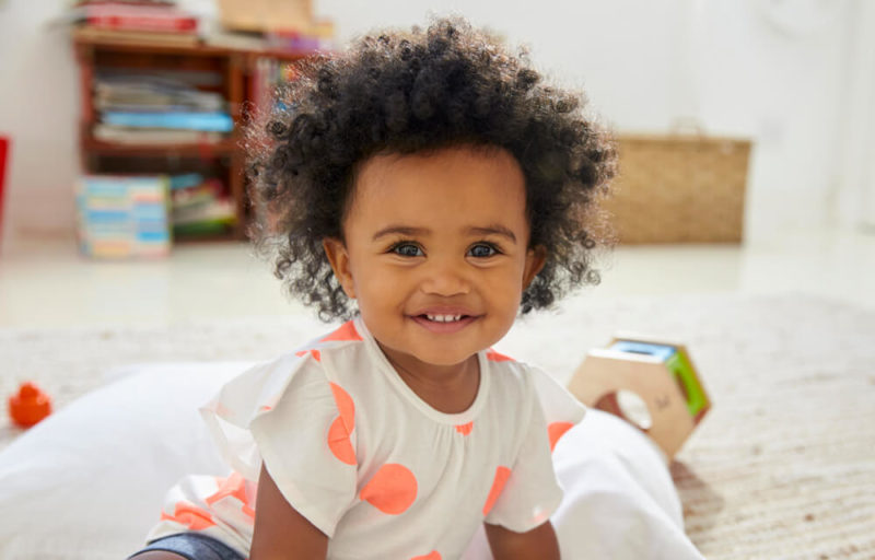 Baby-Girl-Playing-in-Playroom