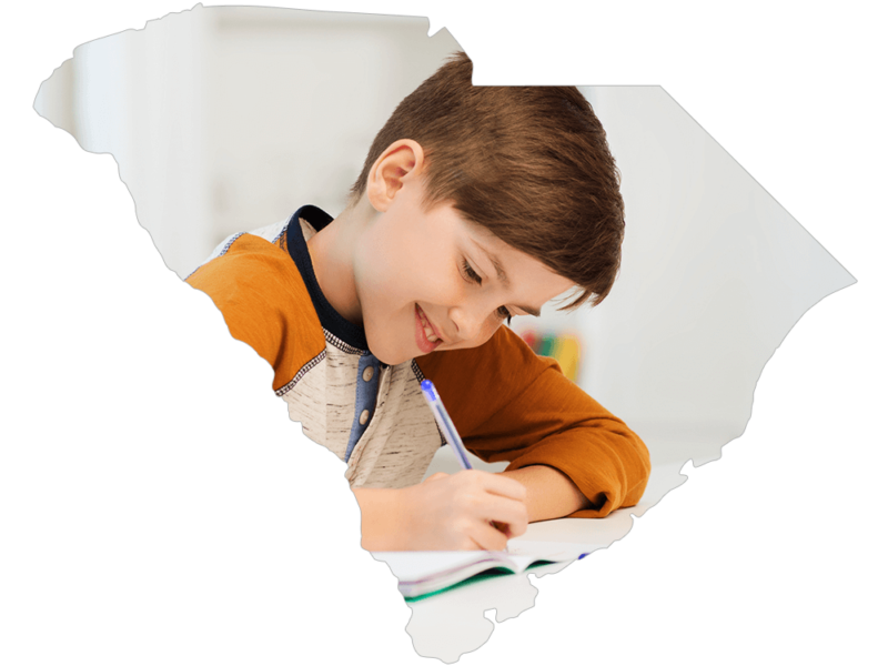 South Carolina shape with photo of young boy doing homework